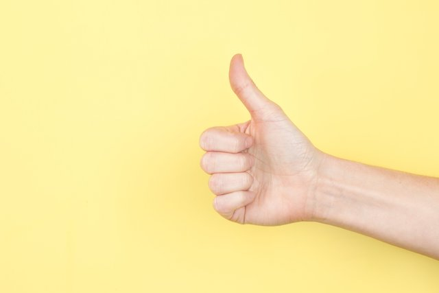 thumbs-up-hand-yellow