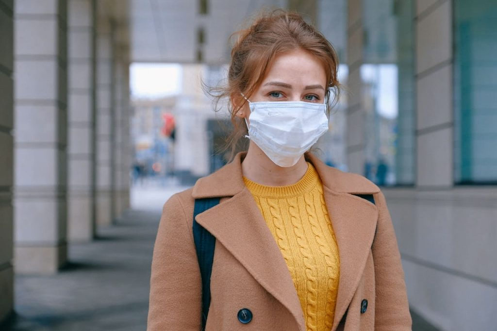 woman wearing a mask as protection from possible infection